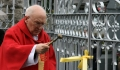 Fr. Whelan blessing the gates